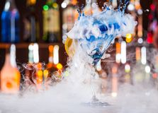 Martini drink served on bar counter Royalty Free Stock Photos