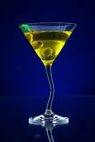 Martini drink served on glass table with ice cubes Royalty Free Stock Images