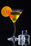 Martini drink served on glass table with ice cubes Royalty Free Stock Photo