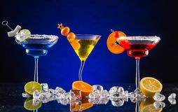 Martini drinks on dark background Royalty Free Stock Images