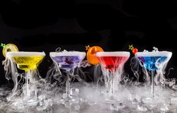 Martini drinks with dry ice smoke effect Stock Image