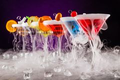 Martini drinks with dry ice smoke effect Royalty Free Stock Image