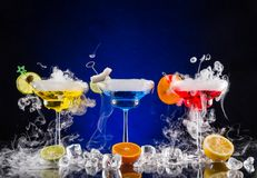 Martini drinks with dry ice smoke effect Royalty Free Stock Photography