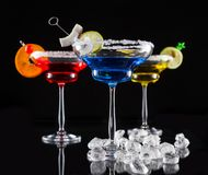 Martini drinks served on glass table Royalty Free Stock Photo