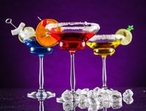 Martini drinks served on glass table Royalty Free Stock Image