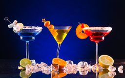 Martini drinks served on glass table Royalty Free Stock Images