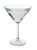 Martini-glas met vloeistof wordt gevuld die. stock afbeelding