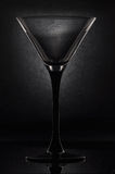 Martini glass. Empty martini glass on a black background Stock Image