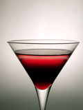 Martini Glass. Cocktail glass with red beverage Stock Photos