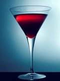 Martini Glass. Cocktail glass with red beverage royalty free stock photo