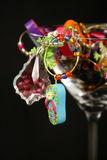 Martini Glass. Full of glass charms with a black background Stock Photos