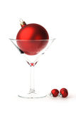 Martini glass with big red bauble Stock Images