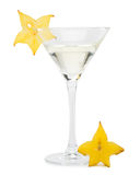 Martini glass and carambola Royalty Free Stock Photography