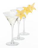 Martini glass and carambola Stock Photos