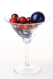 Martini glass with Christmas baubles Royalty Free Stock Photo