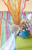 Martini Glass and Cocktail Sticks. On a colorful placemat Stock Image