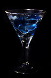 Martini glass in the dark Royalty Free Stock Images