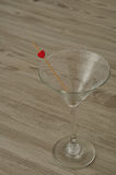 A martini glass decorated with a red heart Stock Images