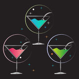 Martini glass drinks party colors black background Royalty Free Stock Photography