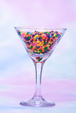 Martini glass filled with candy Stock Photography