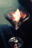 Martini glass with fire Stock Photos