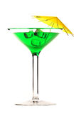Martini glass with green coctail isolated on white Royalty Free Stock Photo