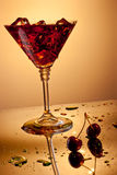 Martini glass with ice and cherries Royalty Free Stock Photos