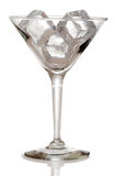 Martini glass with ice cubes Stock Photo