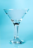 Martini glass on light blue Stock Images