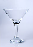 Martini glass on light purple Stock Photos