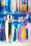Martini glass with liquor and shaker at bar Royalty Free Stock Photo