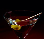 Martini glass and olive Stock Image
