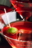 Martini glass with olive and ice cube Stock Photo