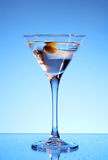 Martini glass with olive inside Royalty Free Stock Photo