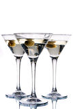 Martini glass with olive inside Stock Images