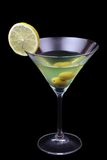 Martini. Glass of martini with olive and lime isolated on black Stock Image