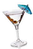 Martini glass with olives and umbrella Stock Image