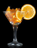 Martini glass with orange Stock Images