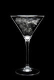 Martini Glass over black with Smoke in Bowl Royalty Free Stock Images