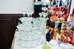Martini glass pyramid at wedding reception. Royalty Free Stock Photos