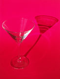 Martini glass on red background Stock Photography