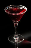 Martini glass with red cocktail Royalty Free Stock Photography