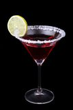Martini. Glass of red martini with lime and sugar rim isolated on black Stock Photography