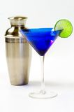 Martini glass and shaker. A classy looking martini glass with a lime wedge and a martini shaker behind it Stock Photo
