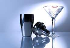 Martini Glass and Shaker. An image of a martini glass with lipstick and a shaker Stock Images