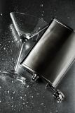 Martini glass and silver flask Stock Photos