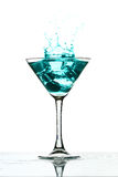 Martini glass splash Stock Image