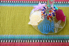 Martini Glass Stem. With glass decoration on a striped placemat Stock Images