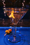 Martini glass with a twist of lemon. An image of a martini glass with a twist of lemon on blue wet bar Royalty Free Stock Photo