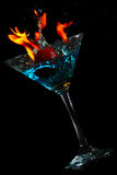 Martini glass with Water and fire Stock Image